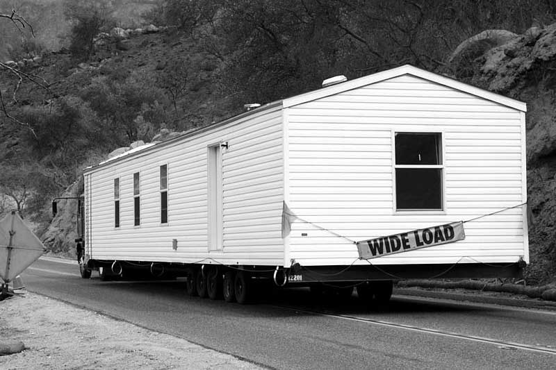 Light Gray Mobile Home Being Delivered
